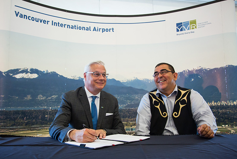 Craig Richmond (L) President and CEO of YVR Airport and Chief Wayne Sparrow of the Musqueam Indian Band sign the Musqueam Indian Band-YVR Airport Sustainability & Friendship Agreement joint announcement at YVR in Richmond, British Columbia on June 21, 2017.