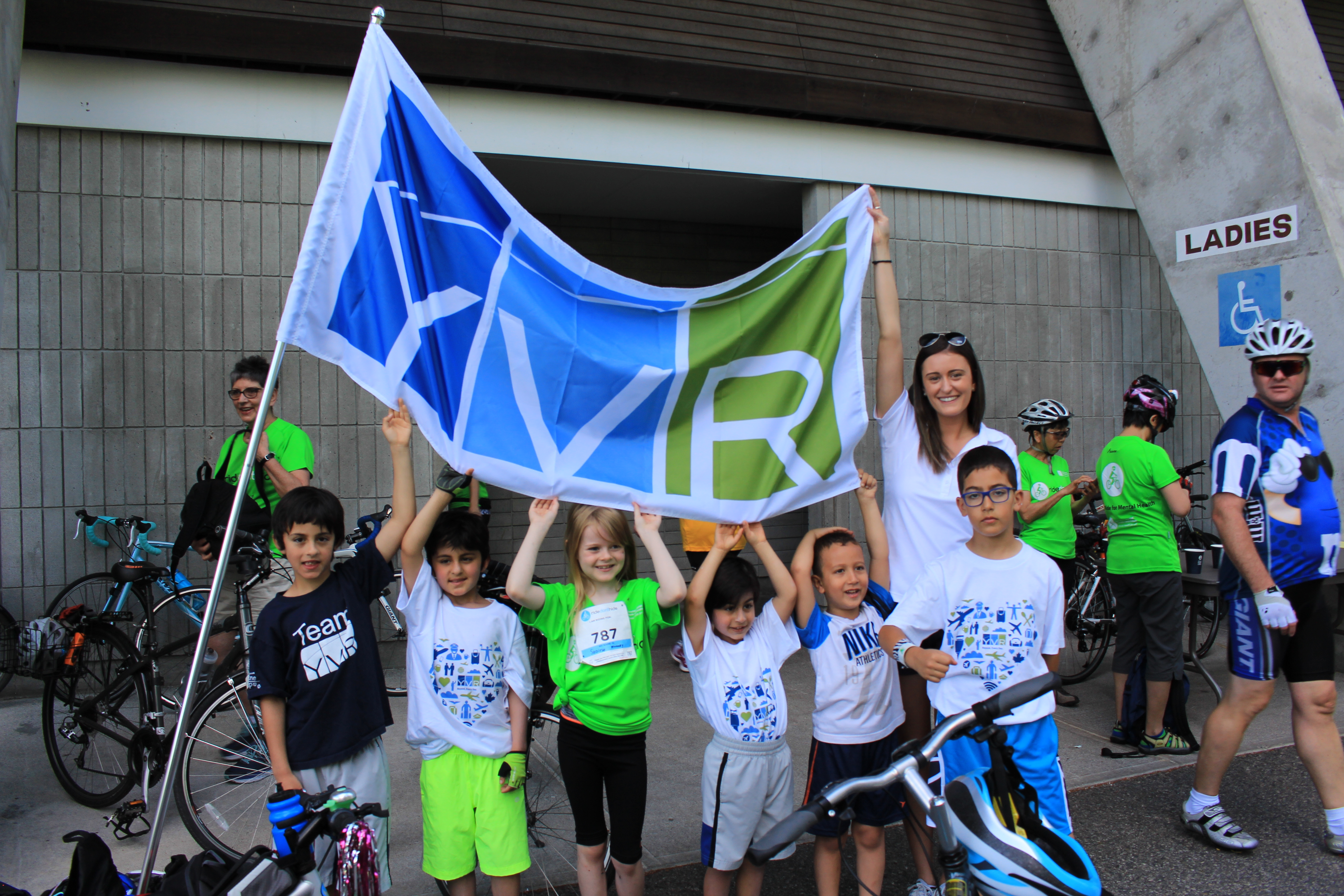 Group photo with children and YVR flag