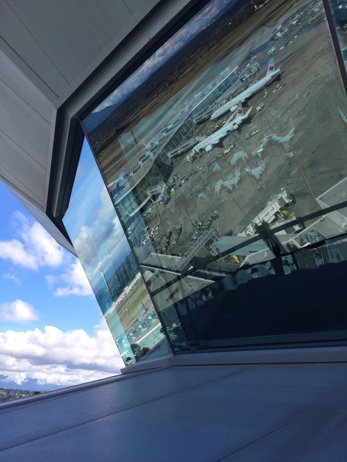 Reflection of the airport on the control tower glass panels