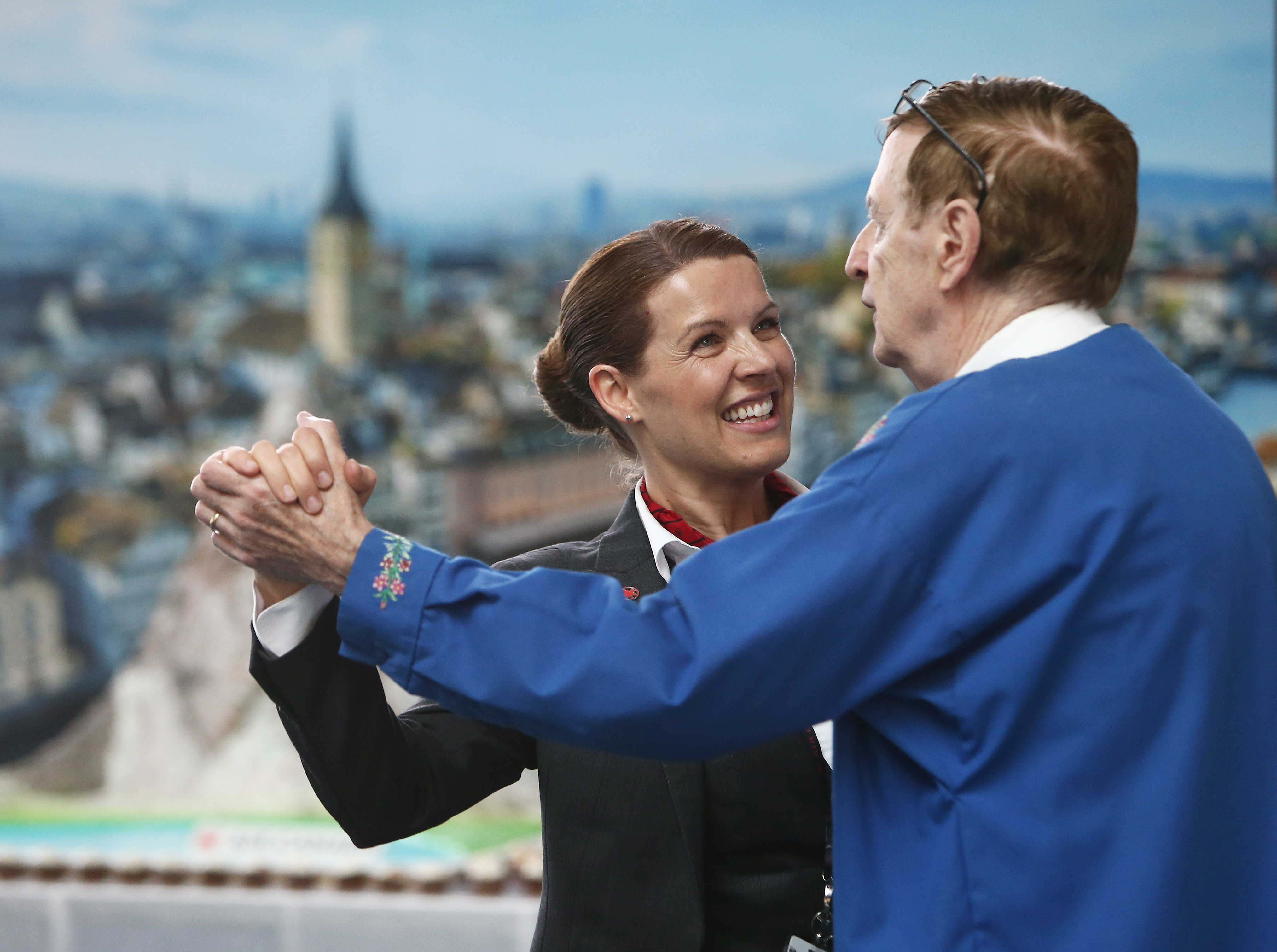 Air Canada flight attendant and a passenger dance together at the Zurich inaugural