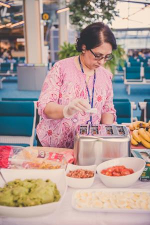 Narinder serving food at a special event