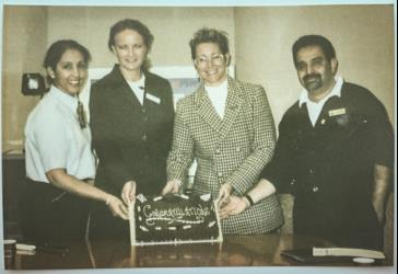 Narinder receiving Congratulations cake for employee of the month