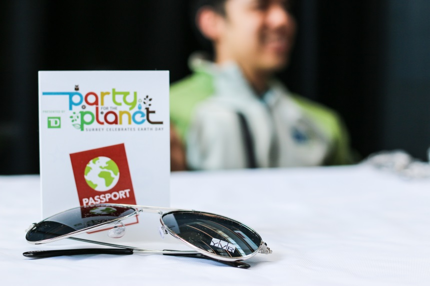 YVR Sunglasses and Party for the Planet branding on table.