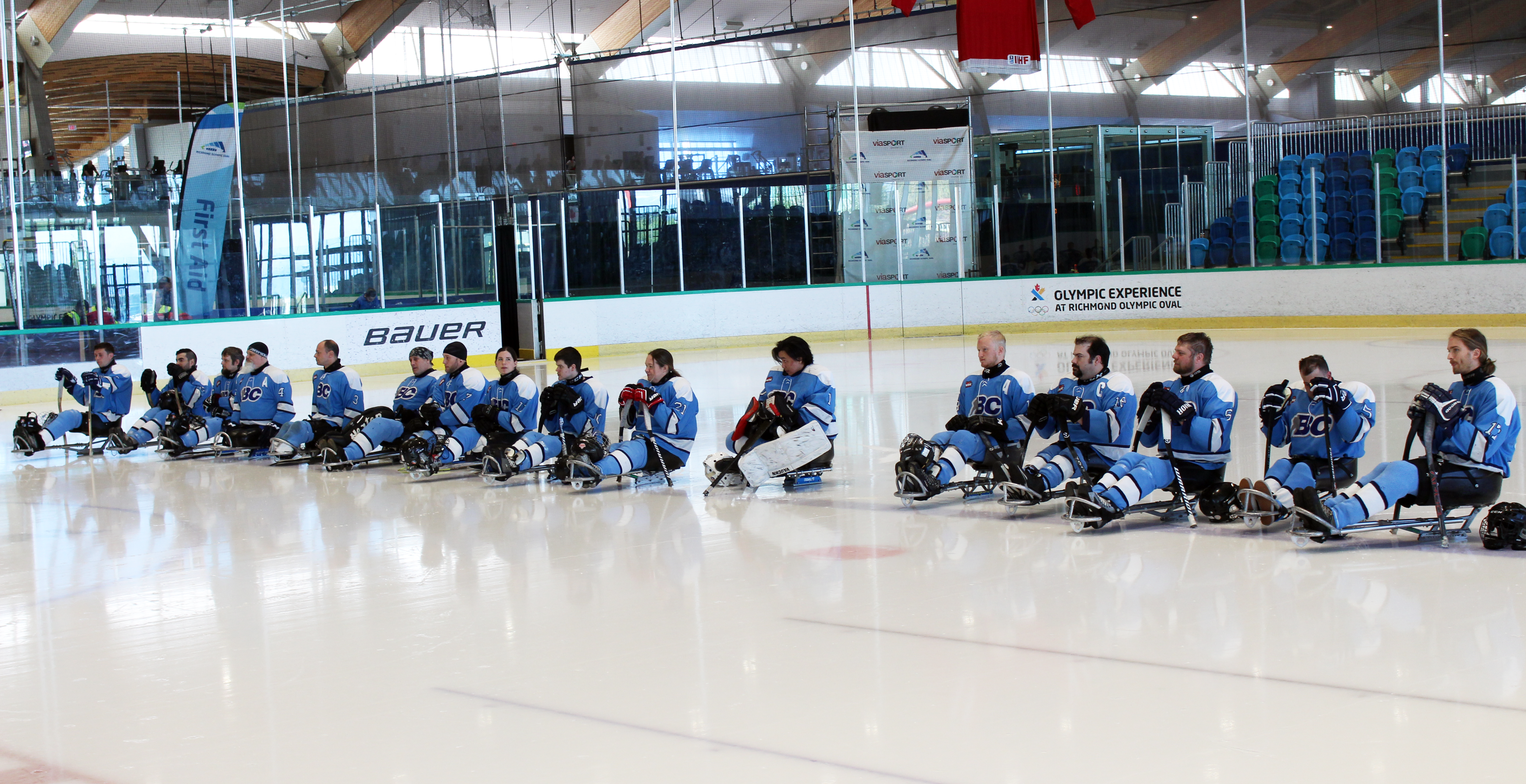 Sledge hockey team lined up on the rink