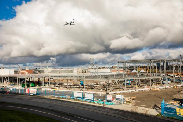 YVR Construction site with a plane flying overhead