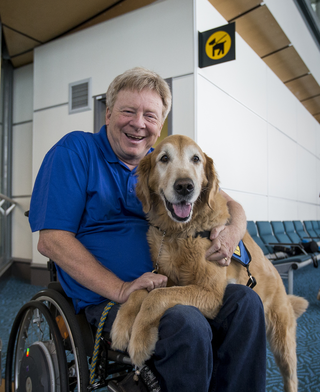 Brad McCannell with his assistance dog in front of YVR's pet relief area