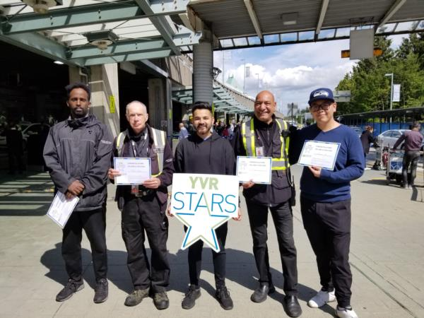 Paladin Group members receiving YVR stars award