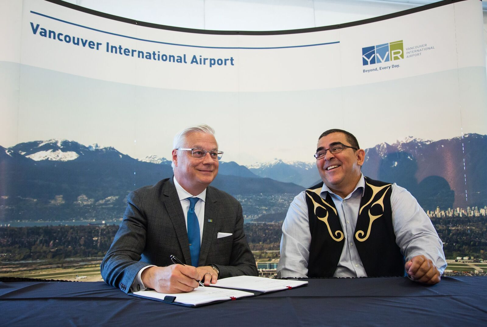 Craig Richmond and Chief Wayne Sparrow of the Musqueam Indian Band at the signing of the 30-year agreement in a YVR hangar