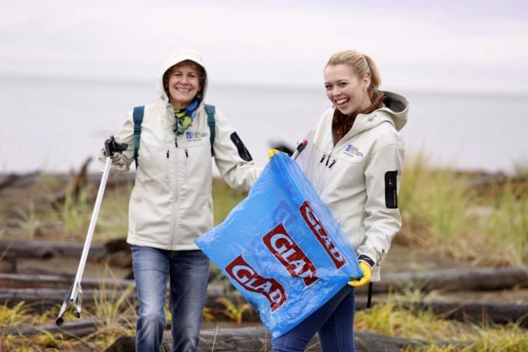 YVR employees picking up garbage on Iona Beach